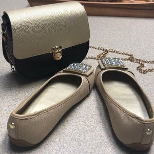 Micheal Kors golden slippers with toe detail